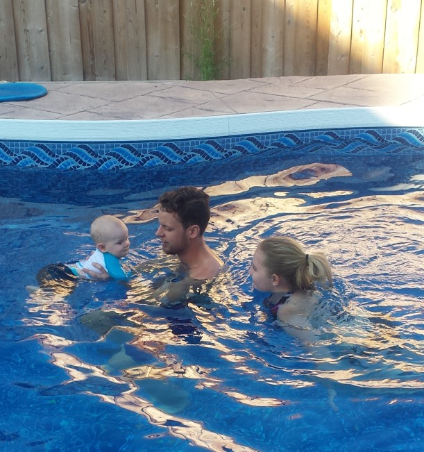 Enjoying an afternoon of fun in the pool with Carly and Nathan.
