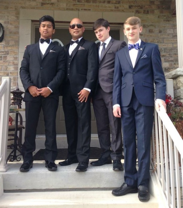 Malik (far left) with his dad and two brothers.
